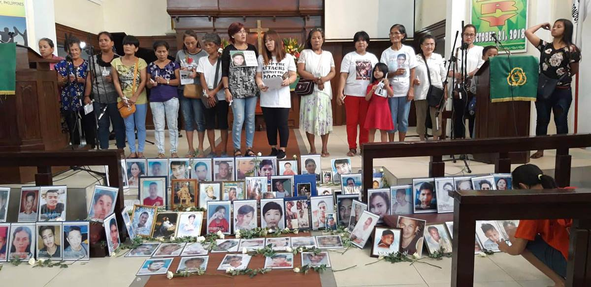 Families gather at St. Paul United Methodist Church in Manila, Philippines, to pay tribute to victims of drug-related violence during a memorial service on All Saints' Day. Photo courtesy of Juliet Solis.