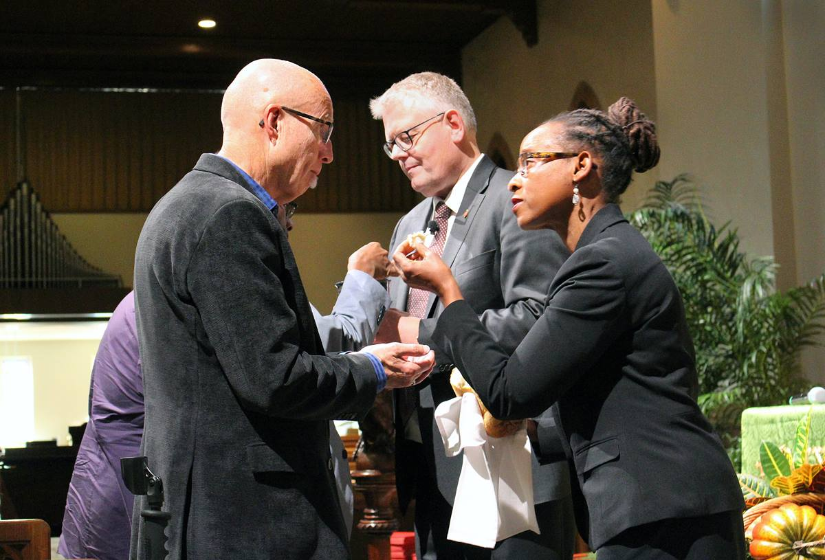 The Connectional Table opens its Oct. 31-Nov. 2 meeting in Atlanta with Holy Communion. From left, the Rev. Mike Slaughter receives the sacrament from Bishop Christian Alsted, Connectional Table chair, and the Rev. Kennetha Bigham-Tsai, chief connectional ministries office. Photo by Emily Clemons, Connectional Table.