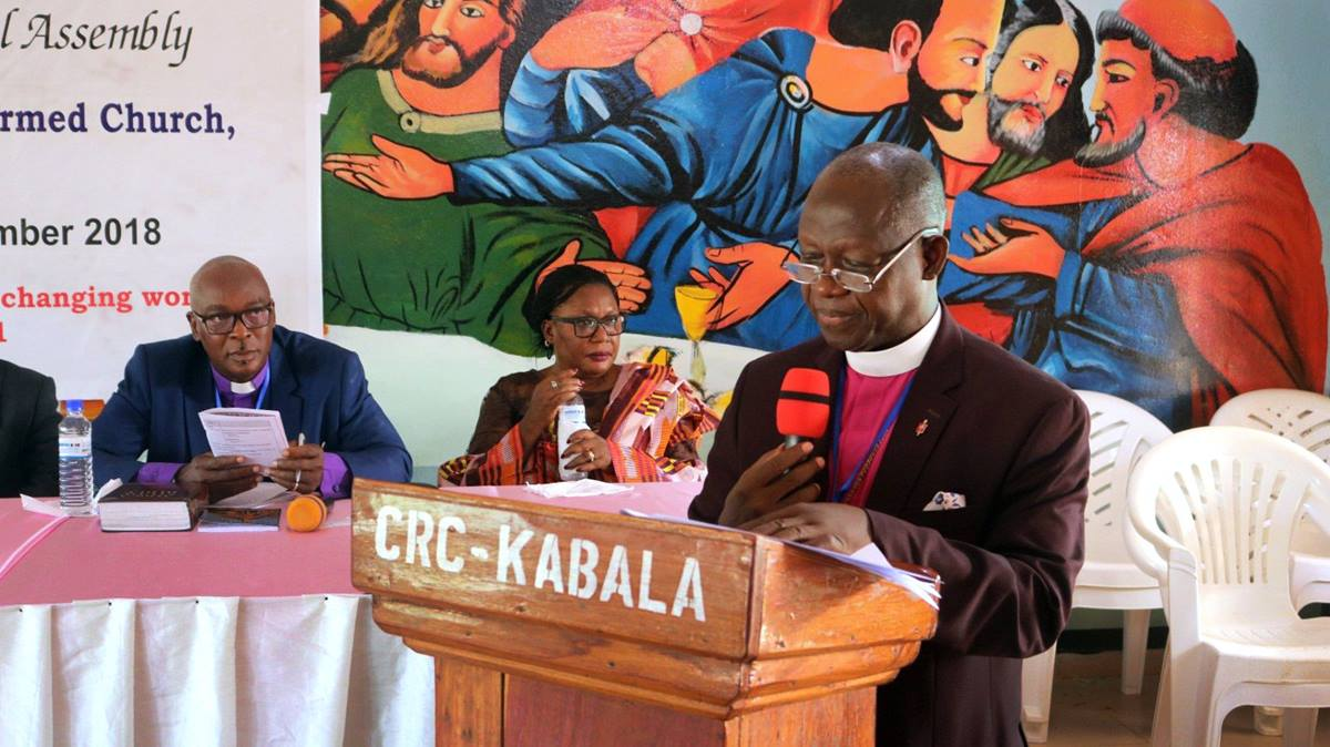 Bishop John K. Yambasu, president of the Council of Churches in Sierra Leone, delivers his presidential address in Kabala, Sierra Leone, in September. He said the church has engaged in research and dialogue to minimize the practice of female genital mutilation. Photo by Keziah Kargbo.
