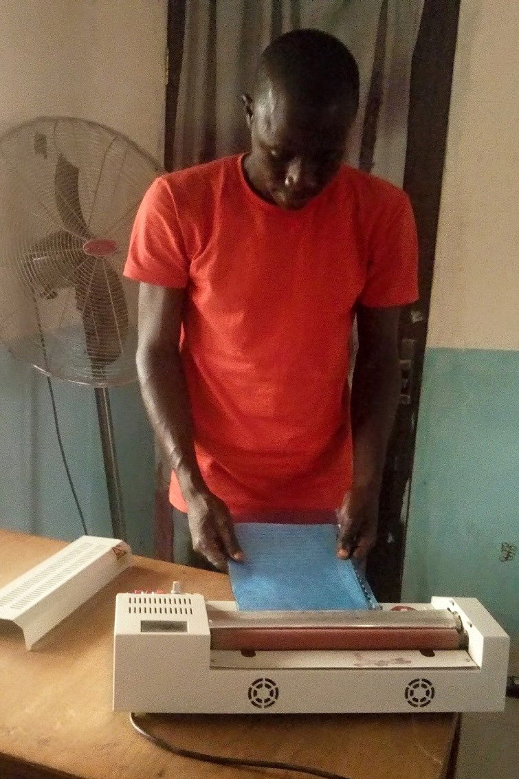 A student makes photocopies at the Northern Nigeria Conference's computer training center in Gombe, Nigeria. The center has a new solar energy system that is helping the conference and its students save money. Photo by Daniel Garba.