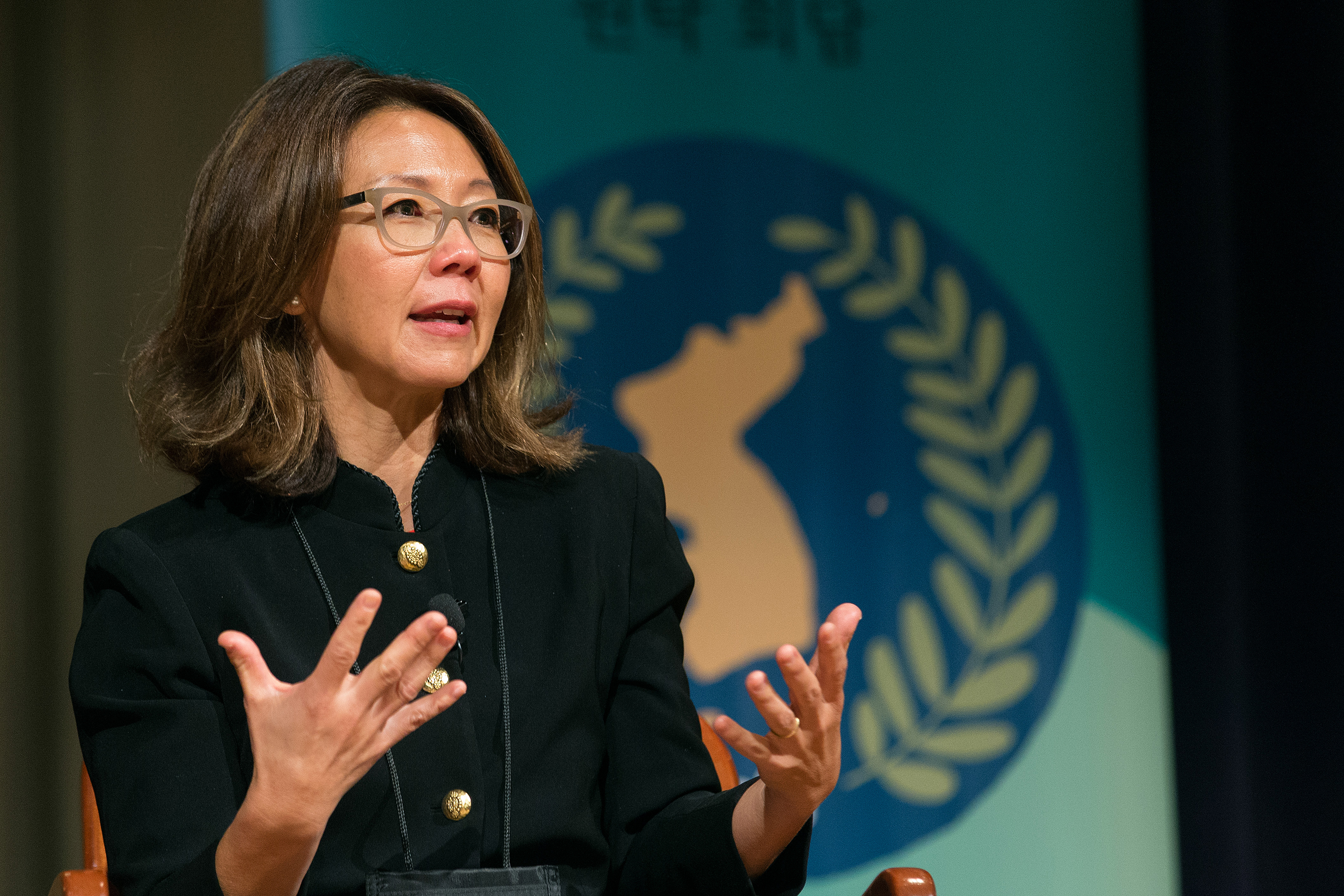 Christine Ahn speaks during the Roundtable for Peace on the Korean Peninsula in Atlanta. Ahn is founder of Women Cross DMZ, a global movement of women mobilizing to end the Korean War. Photo by Mike DuBose, UMNS.