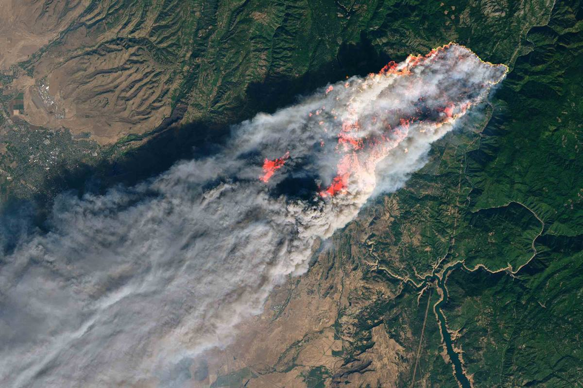 A satellite image shows smoke pouring from a wildfire that broke out in the early morning hours of Nov. 8, just outside Paradise, Ca. The Camp Fire, named for its proximity to Camp Creek Road in Feather River Canyon, has overtaken and nearly burned out the town of 30,000 residents located in northern California. NASA Earth Observatory image by Joshua Stevens, using Landsat data from the U.S. Geological Survey.