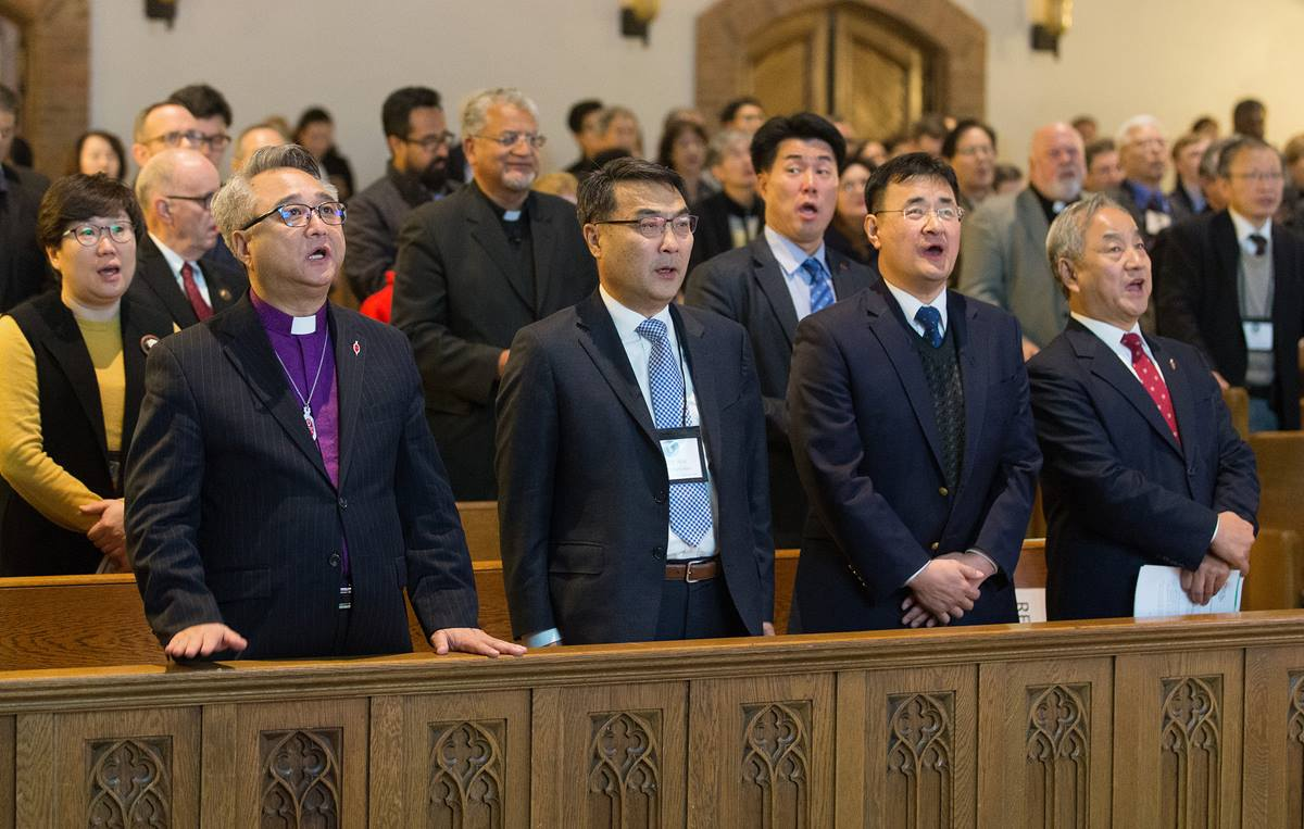 Delegates and guests sing during closing worship at the Roundtable for Peace on the Korean Peninsula at Grace United Methodist Church in Atlanta. Front row, from left are: Bishop John Higon Eun, American Conference of the Korean Methodist Church; the Rev. Chongho James Kim, First United Methodist Church of Flushing, N.Y.; the Rev. Kim Sei Hwan, Korean Church of Atlanta United Methodist Church; and Bishop Hee-Soo Jung, Wisconsin Conference of The United Methodist Church. Photo by Mike DuBose, UMNS.