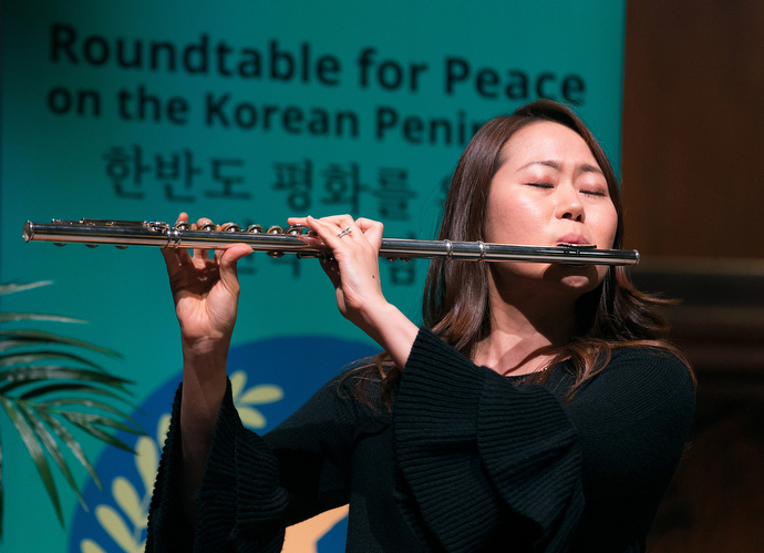 Yoonyung Seo plays the flute during closing worship at the Roundtable for Peace on the Korean Peninsula at Grace United Methodist Church in Atlanta. Photo by Mike DuBose, UMNS.