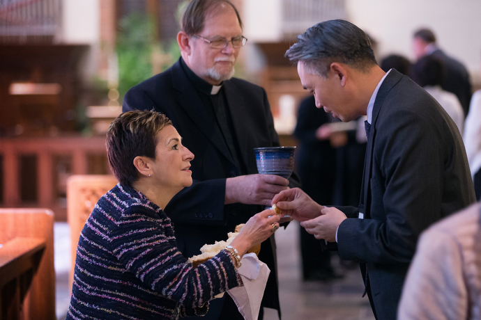 United Methodist Bishop Cynthia Fierro Harvey (left) and the Rev. Chris Ferguson of the World Communion of Reformed Churches serve Holy Communion during closing worship at the roundtable. Photo by Mike DuBose, UMNS.
