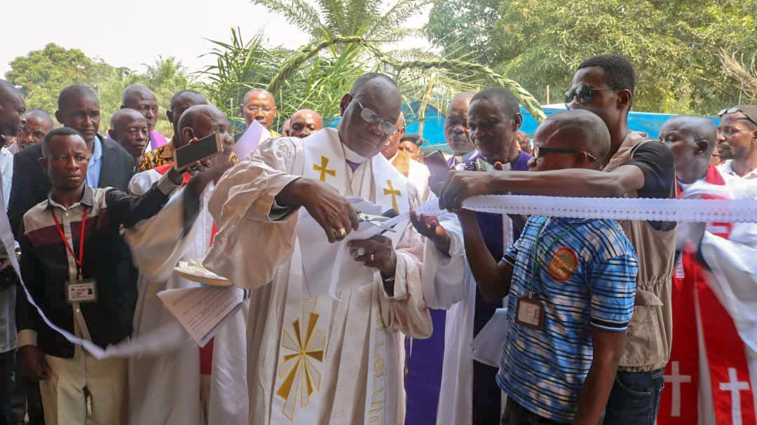 Bishop Gabriel Yemba Unda cuts the ribbon during the inauguration of the new medical center in Okasa village. Photo by Chadrack Tambwe Londe, UMNS