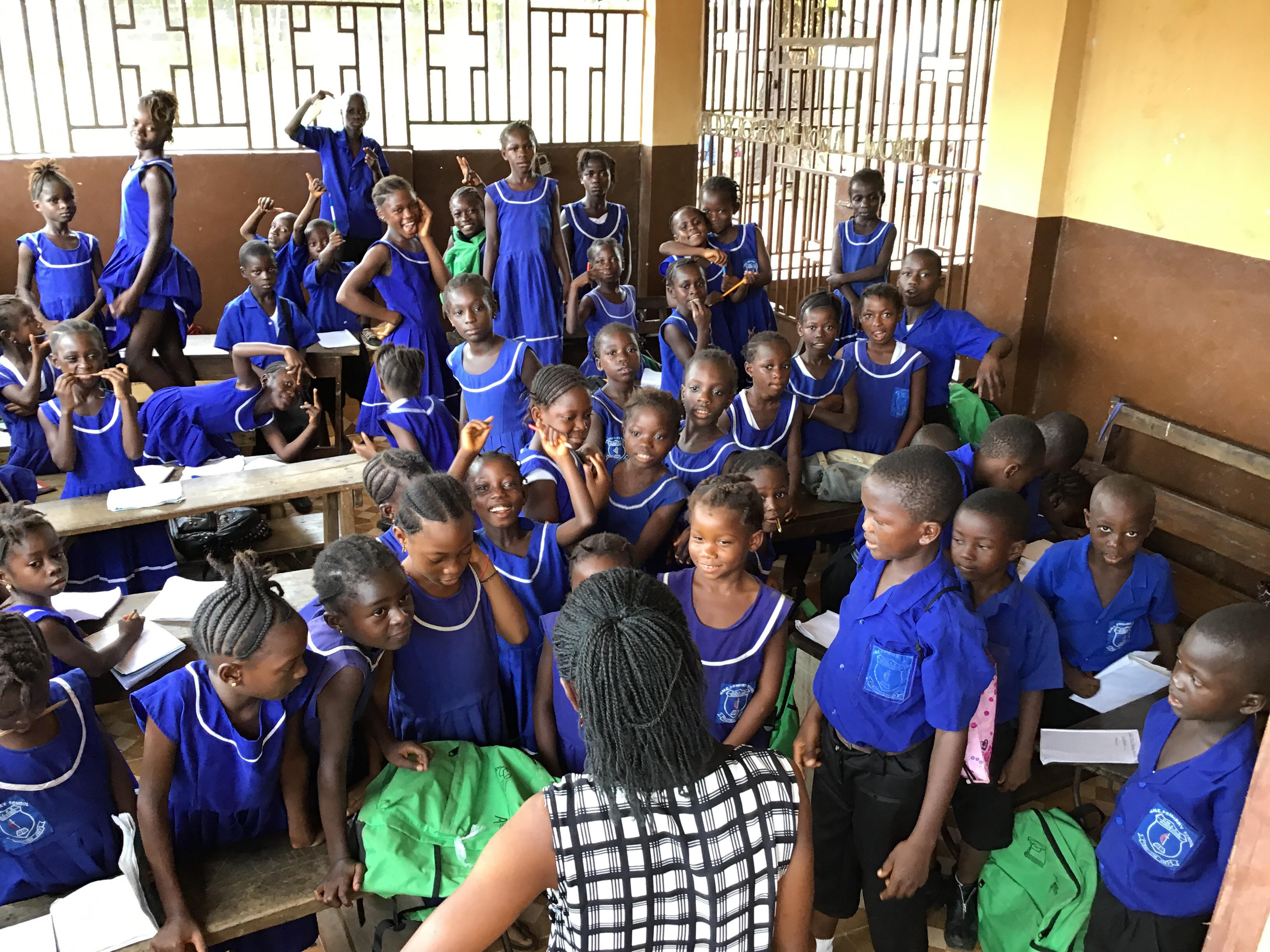 Increased admissions due to the government free education policy have caused some classes of United Methodist Church Primary School in Njagboima to temporarily relocate in the porch of the Rogers Memorial United Methodist Church. Photo by Phileas Jusu, UMNS.