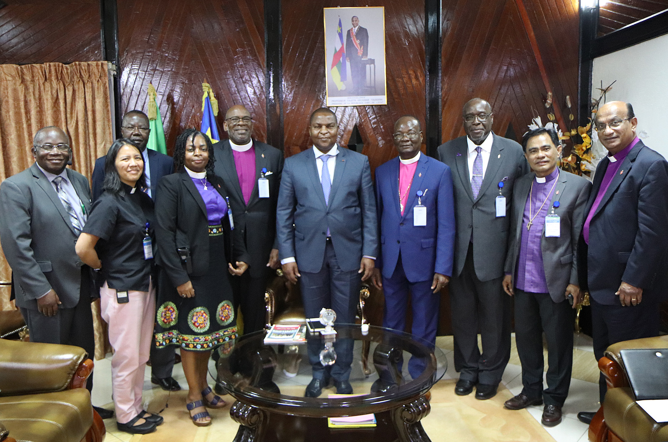 Members of The United Methodist Church Council of Bishops and Board of Global Ministries pose for a photo with Central Africa Republic President Faustin-Archange Touadéra in Bangui, Central Africa Republic. The delegation visited the country and Kenya Nov. 12-18. Photo by Isaac Broune, UMNS.