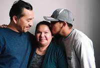 Samuel Oliver-Bruno, (left) hugs his wife and son in a photo taken earlier this year. Oliver-Bruno had taken refuge in CityWell United Methodist Church in Durham, N.C., while applying to remain in the U.S. to care for his ill wife. He was arrested by ICE officials Nov. 23. Photo by Anna Carson Dewitt, courtesy of CityWell United Methodist Church.