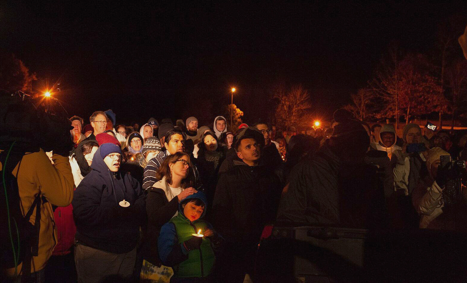 People gather for a prayer service for Samuel Oliver-Bruno outside the Cary, N.C., ICE office on Nov. 27. Photo by Anna Carson Dewitt, courtesy of CityWell United Methodist Church.