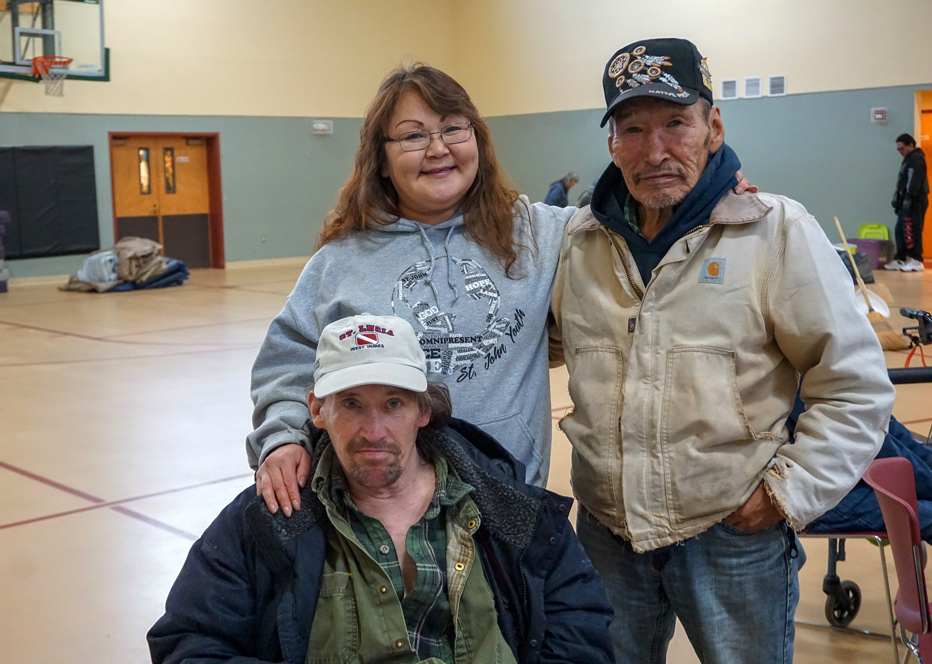 Betty Sanchez Sopcak (l), her husband Daniel (bottom), and her uncle James Sugar (r) take shelter with other residents of Karluk Manor at St. John United Methodist Church after the Nov. 30 earthquake. Photo by Anne Hillman, courtesy of Alaska Public Media.