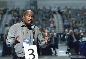 The Rev. Forbes Matonga, a clergy delegate from the United Methodist Church Zimbabwe Episcopal Area, speaks to the 2016 United Methodist General Conference in Portland, Ore., on May 11. Photo by Paul Jeffrey, UMNS.