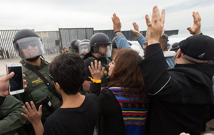 United Methodist Bishop Minerva Carcaño (center) and other faith leaders face U.S. Border Patrol agents at the fence between the U.S. and Mexico in San Diego as they attempt to offer a ceremonial blessing in support of migrants seeking refuge in the U.S. Photo by Mike DuBose, UMNS.