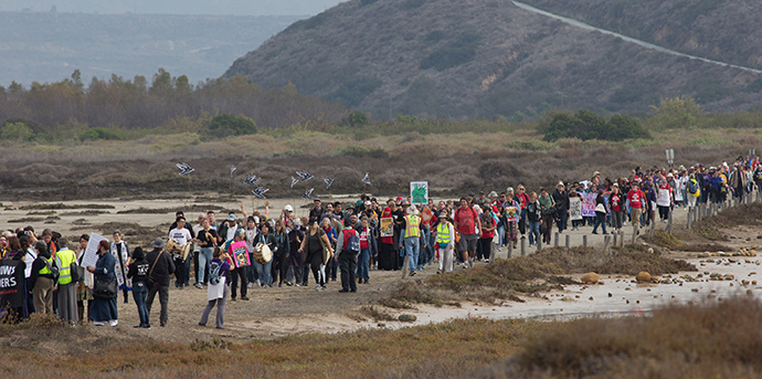 Faith leaders and supporters of immigrant rights march for migrant justice at Border Field State Park in San Diego. Photo by Mike DuBose, UMNS.