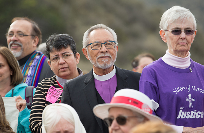United Methodist Bishop Elias Galvan (center right) and the Rev. Patricia Gandarilla of El Buen Pastor United Methodist Church in Detroit take part in a press conference for faith leaders prior to a march for immigrant rights In San Diego. Photo by Mike DuBose, UMNS.