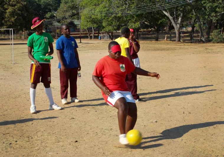 Monalisa Makoma, a student at Murewa United Methodist High School in Zimbabwe, kicks the ball during practice for the International Blind Soccer Association's upcoming women's training camp and games in Japan. Photo by Chenayi Kumuterera, UMNS.