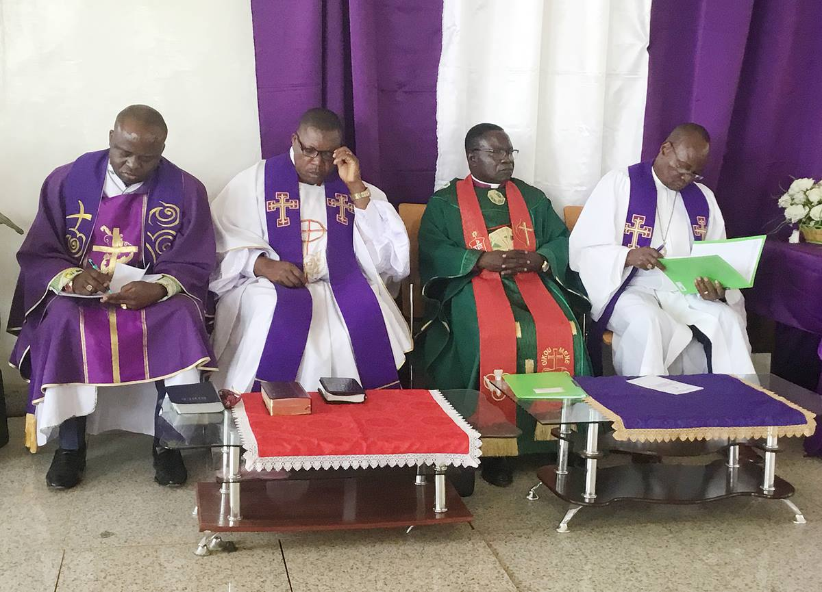 From left, Bishops Mande Muyombo, Daniel Lunge, Kasap Owan and Gabriel Yemba Unda attend the opening church service at a special meeting of the Congo Central Conference Dec. 11 in Kolwezi, Congo. Photo by Pierre T. Omadjela.