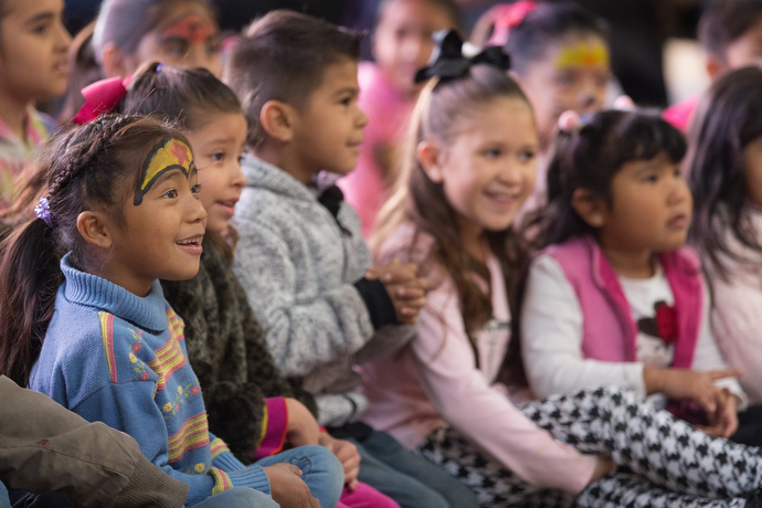 Children watch a skit during the Christmas party. Photo by Mike DuBose, UMNS.