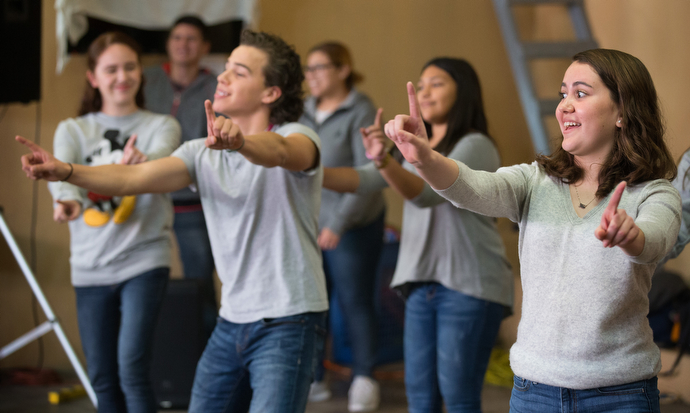 Youth from Nuevo Pacto Methodist Church lead a dance during the Christmas party.
