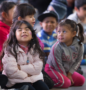 Children pray during a Christmas party at the Door of Hope Salvation Army shelter in Tijuana, Mexico. Migrant children who are staying with their mothers at the shelter joined with kids from the neighborhood and volunteers from the Methodist Church of Mexico in the celebration.