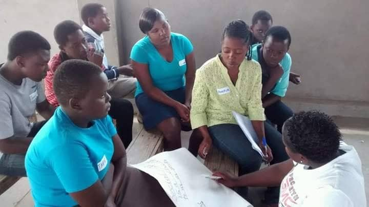 Youth from Gormonzi United Methodist Church youth discuss internet security as part of a guidance and counseling session around issues of human trafficking. Photo by Priscilla Muzerengwa, UMNS.