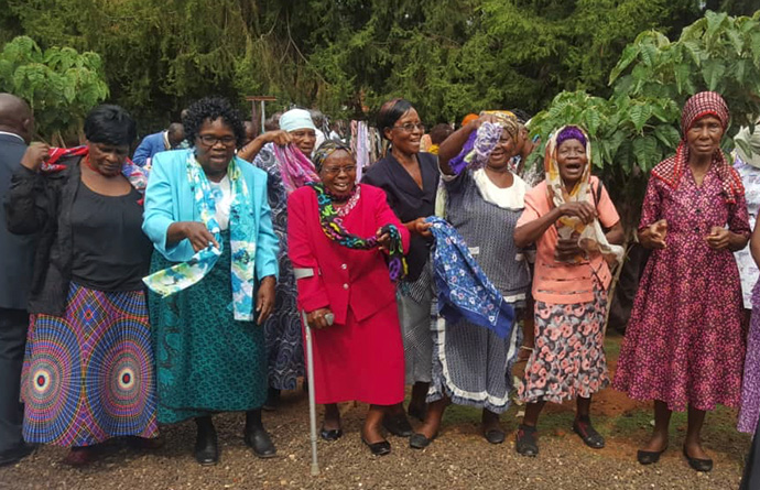 Women in Bulawayo, Zimbabwe, show off the new scarves they received as gifts from The United Methodist Church. More than 100 senior citizens received free health consultations and treatment during a medical outreach program and Christmas party to commemorate Elderly Day. Photo by Kudzai Chingwe, UMNS.