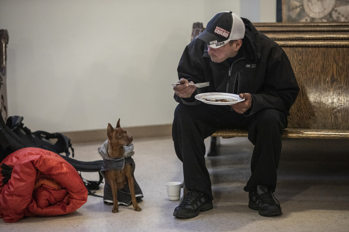 Mike Priest attends Sunday breakfast for the homeless at First United Methodist Church in Salt Lake City where pets are welcome.