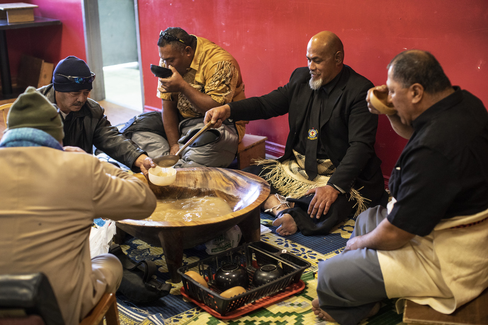 Elders of the church gather in community over the traditional kava kava drink after the Sunday service. Sentiuli Fungalei (goatee) ladles kava for the group.