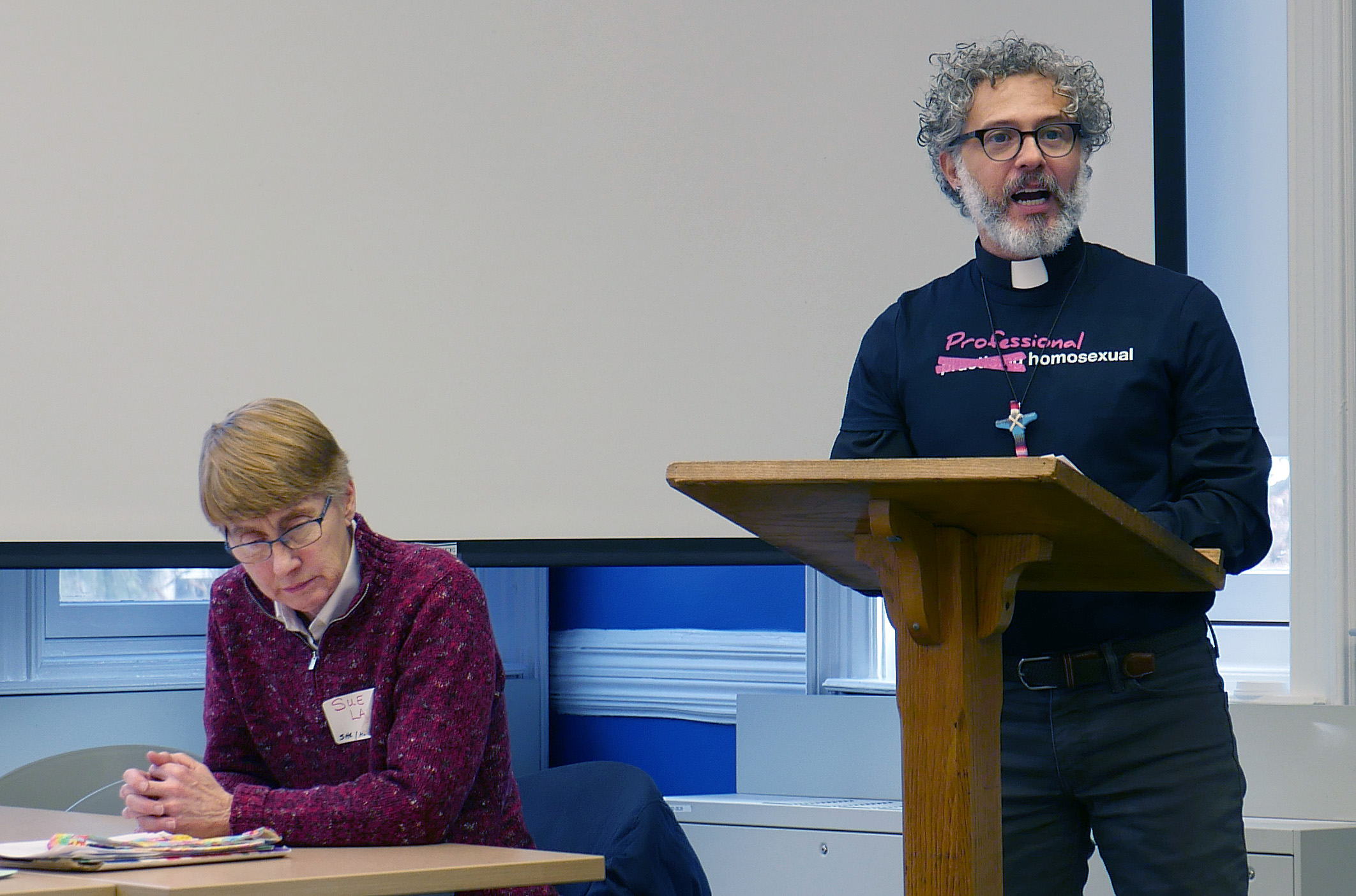 The Rev. Alex da Silva Souto, pastor and co-convener of the unofficial United Methodist Queer Clergy Caucus, talks about the Simple Plan. Sue Laurie, a longtime activist for LGBTQ equality in the church, sits listening. Photo by Heather Hahn, UMNS.