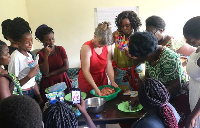 Christina Schmidt, a volunteer with the Malawi Conference women's organization, teaches young women how to make meatballs during training in Blantyre, Malawi. Photo by Francis Nkhoma, UMNS.