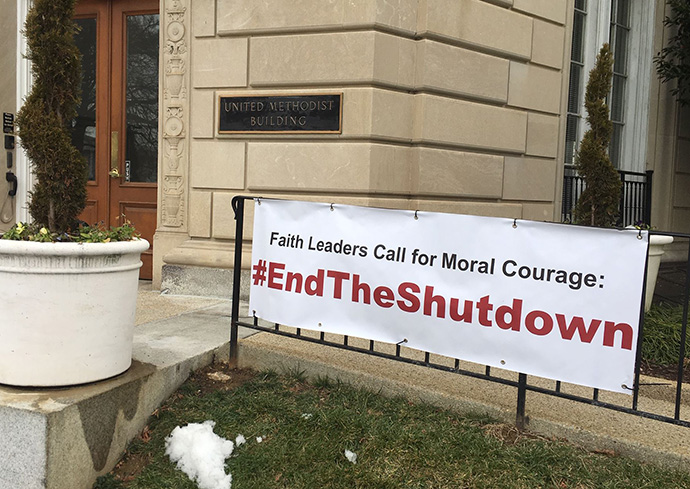 A sign calling for the end of the government shutdown is posted outside the United Methodist Building during day 2  of the shutdown. Photo by Melissa Lauber, Baltimore-Washington Conference.