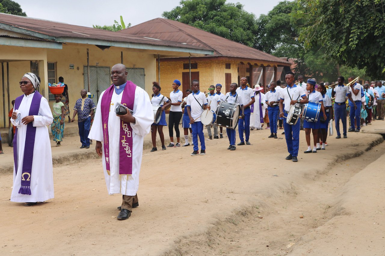 Grace United Methodist Church of Baiwalla celebrated its five-year anniversary in Kailahun, Sierra Leone. Church members marched through the streets as a way to celebrate and evangelize in this predominantly Muslim community. Photo by Phileas Jusu, UMNS.