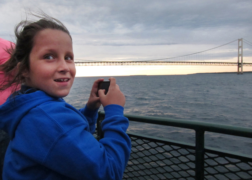 St. Ignace United Methodist Church's Allison Colegrove celebrates her 10th birthday riding the evening Vesper Cruise, which travels in the Straits of Mackinac and beneath the Mackinac Bridge.