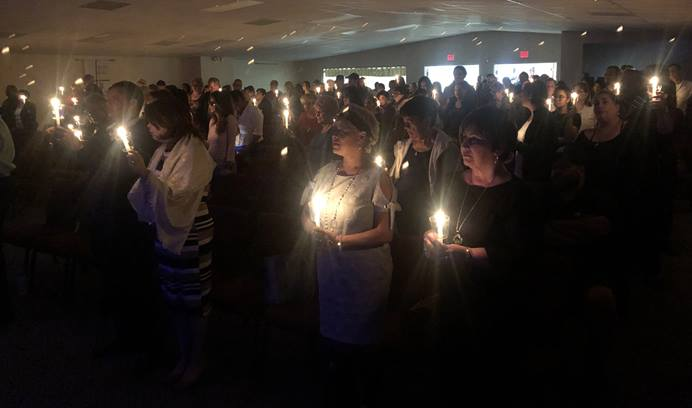 Close to 200 people gather for a candlelight vigil Jan. 24 at Nuevo Pacto United Methodist Church in Sebring, Fla., in memory of Marisol Lopez. Photo by Juan A. Maldonado for UMNS.