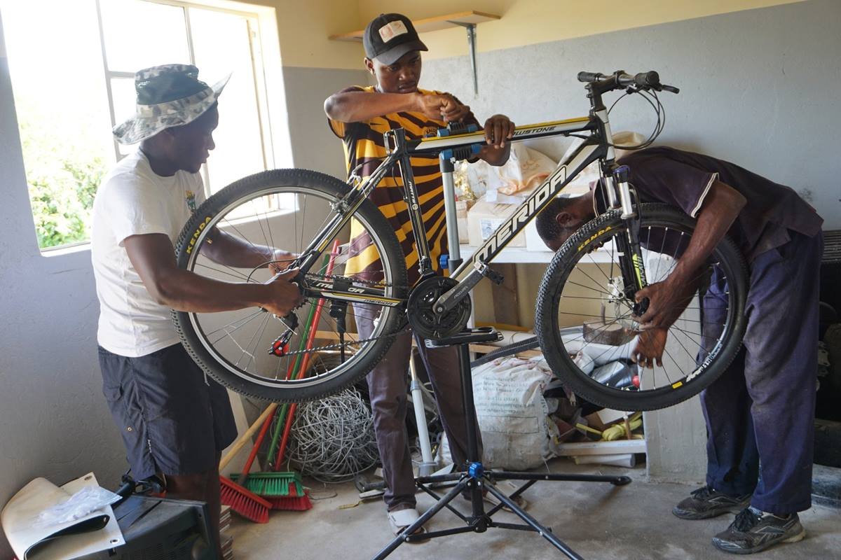 Gedion Mawoneke, Benjamin Dhliwayo and Damion Mutinhiri assemble a bicycle. United Methodist Church's St. John's Circuit in Mutare, Zimbabwe, is helping those in the Deaf community learn skills through the Holy Bike Sales project. Photo by Kudzai Chingwe.