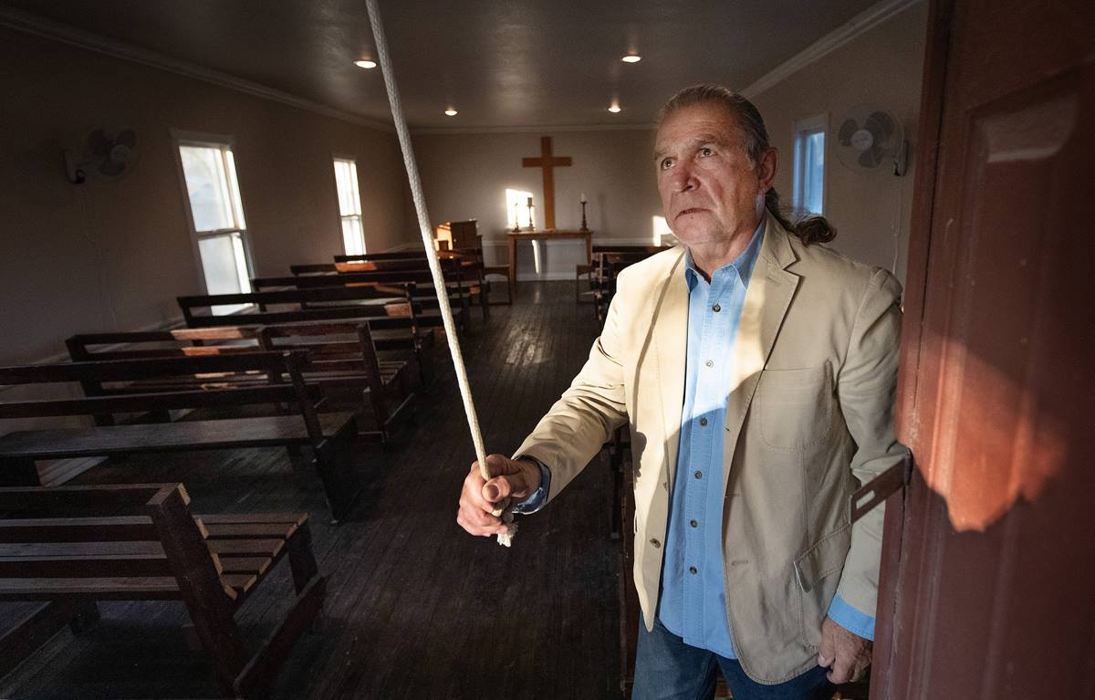 Ramiro Ramírez rings the bell at Jackson Chapel United Methodist Church in San Juan, Texas. Ramírez' family donated land for the church, which was established in 1874. President Trump's proposed border wall is slated to run through the church property, including its historic cemetery. Photo by Mike DuBose, UMNS.