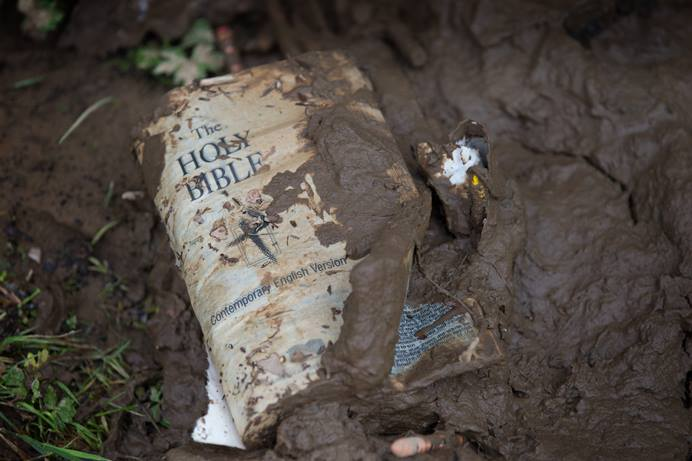 A Bible coated in mud lays outside Fenwick (W. Va.) United Methodist Church following heavy flooding. Photo by Mike DuBose, UMNS