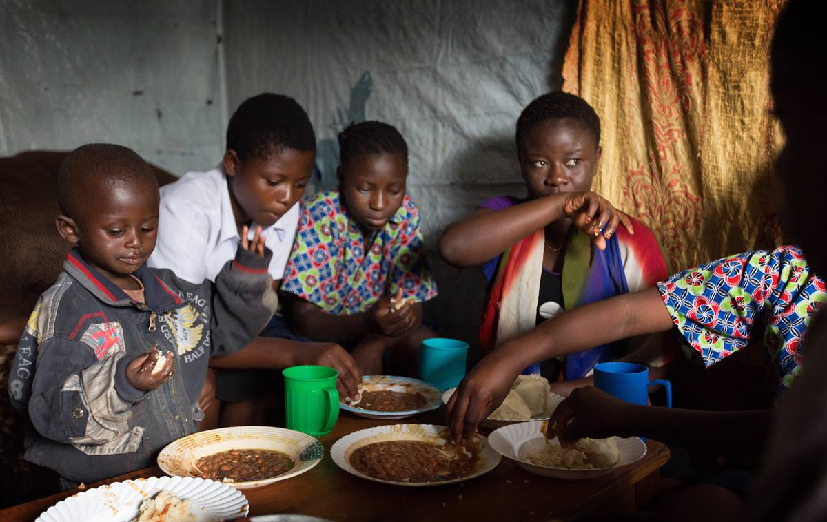 Children share their one daily meal at the United Methodist orphanage in Goma, Congo, in 2015. United Methodists joined other faith groups at the United Nations during a symposium to explore how best to support the U.N.'s Sustainable Development Goals for improving human lives. File photo by Mike DuBose, UMNS.