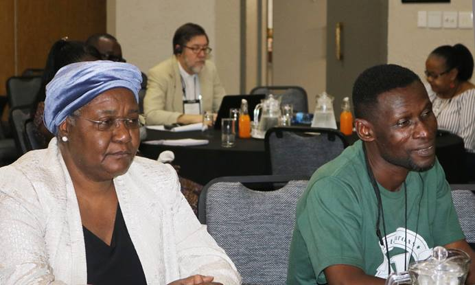 Bishop Joaquina F. Nhanala of Mozambique and agricultural missionary Innocent Afful listen to The United Methodist Church's plans for existing land in Africa during an agricultural summit held Jan. 13-16 in Johannesburg. Photo by Eveline Chikwanah.
