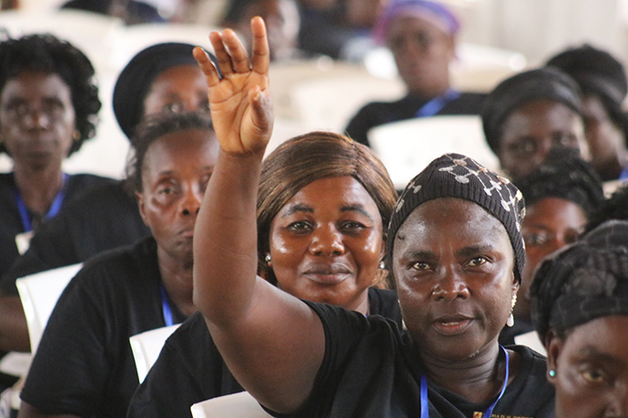 A participant asks a question about leadership roles for women during United Methodist Women's 72nd annual gathering in Marshall, Liberia. Photo by E Julu Swen, UMNS.