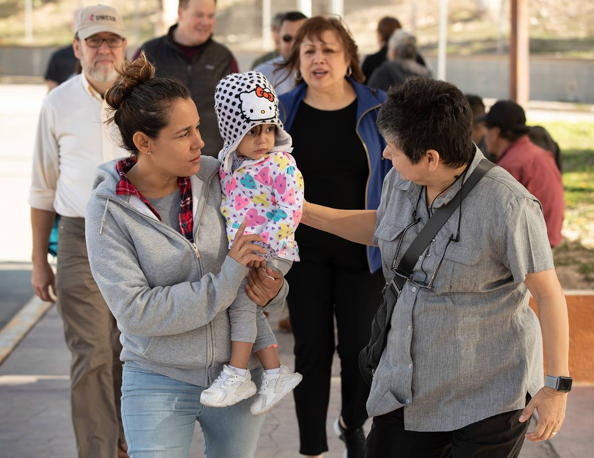 United Methodist deaconess Cindy Johnson (right) walks to buy medicine with Isabél who traveled with her daughter from Nicaragua to Matamoros, Mexico, hoping to request asylum in the U.S. Kassandra, 16 months, was suffering from fever and weight loss while she and her mother waited for their turn to approach the bridge leading to Brownsville, Texas. Johnson, who makes regular visits to the makeshift camp, brought members of the United Methodist Immigration Task Force for a firsthand look at the immigration situation. Photo by Mike DuBose, UMNS.
