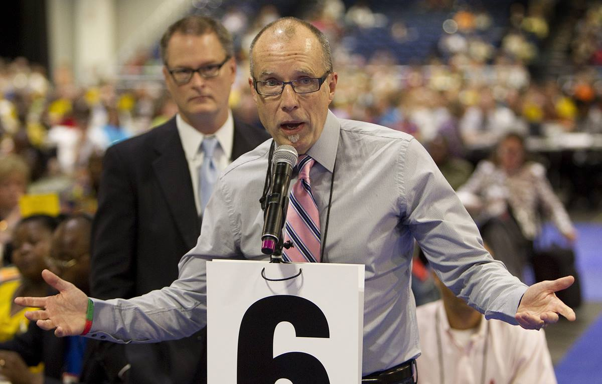 The Revs. Mike Slaughter (front) and Adam Hamilton speak in favor of legislation during the denomination's 2012 General Conference in Tampa, Fla. The two are part of Uniting Methodists, which is urging delegates at 2019 General Conference to delay until 2020 passing an exit plan for churches. Photo by Mike DuBose, UMNS.