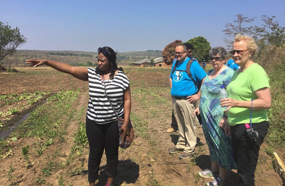 Lorraine Charinda, a missionary from Zimbabwe, shows visitors from the West Ohio Conference around Kamisamba Farm in North Katanga, Congo. West Ohio is the partner conference of the North Katanga and Tanganyika conferences. Photo courtesy of Lorraine Charinda.