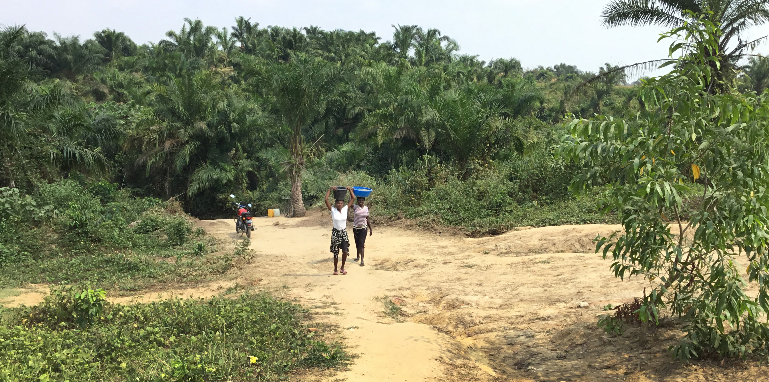 A long dirt road leads to a source for clean water in the East Congo. Photo by Judith Osongo Yanga