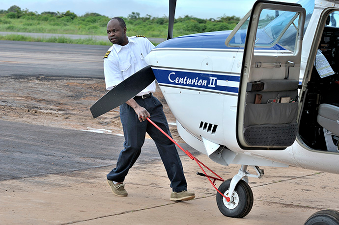 Rukang Chikomb, a pilot with the Wings of the Morning aviation ministry of The United Methodist Church, guides a plane into the program's hanger in Lubumbashi, Congo, in 2008.  File photo by Paul Jeffrey.