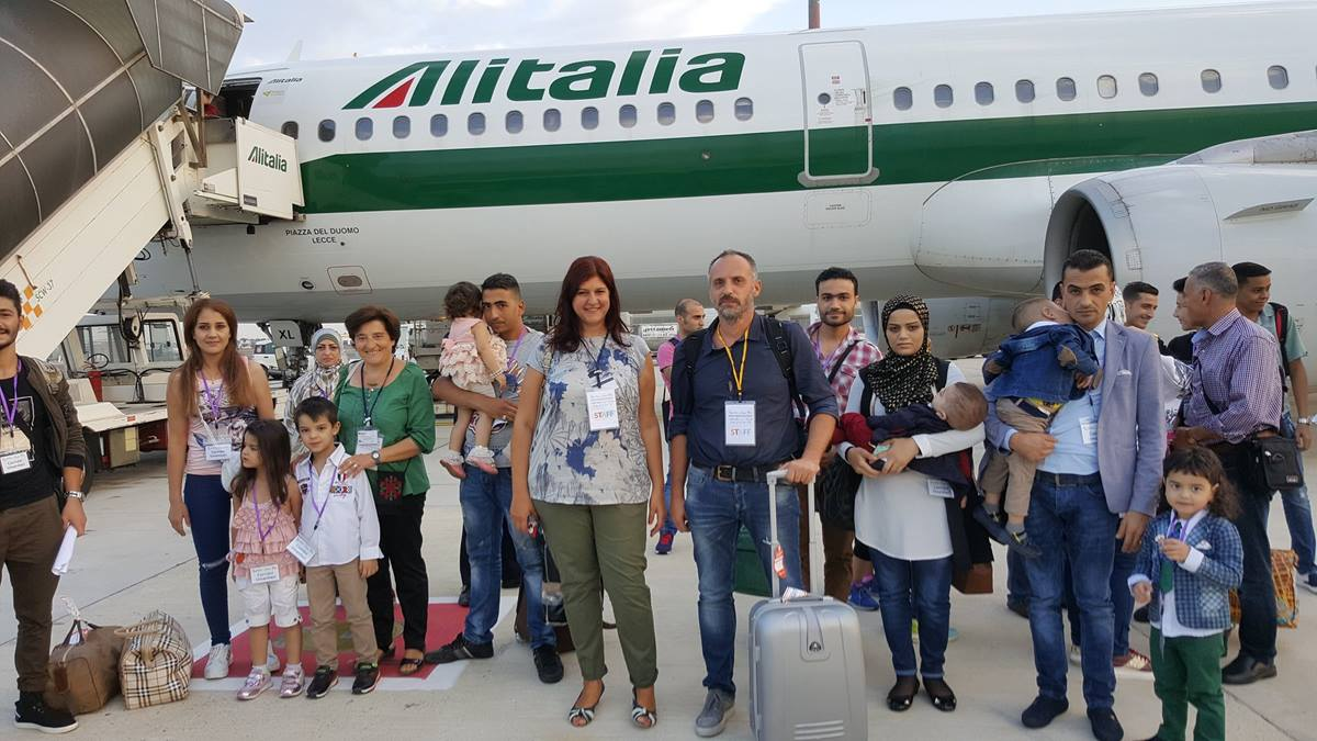 Asylum-seekers from Lebanon are greeted by Federica Brizi and Francesco Piobbichi of the Federation of Evangelical Churches in Italy (center) upon their arrival in Rome in August 2017. The group obtained legal visas through the Humanitarian Corridors program of the federation, the Synod of Waldensian and Methodist Churches and the Community of Sant'Egidio, run by Mediterranean Hope. Photo courtesy of Mediterranean Hope.