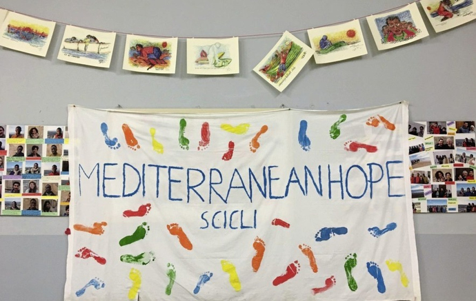 A homemade banner hangs on the wall at the House of Cultures in Scicli, Italy. The project was started by local Methodists and Mediterranean Hope. Photo courtesy of Mediterranean Hope.