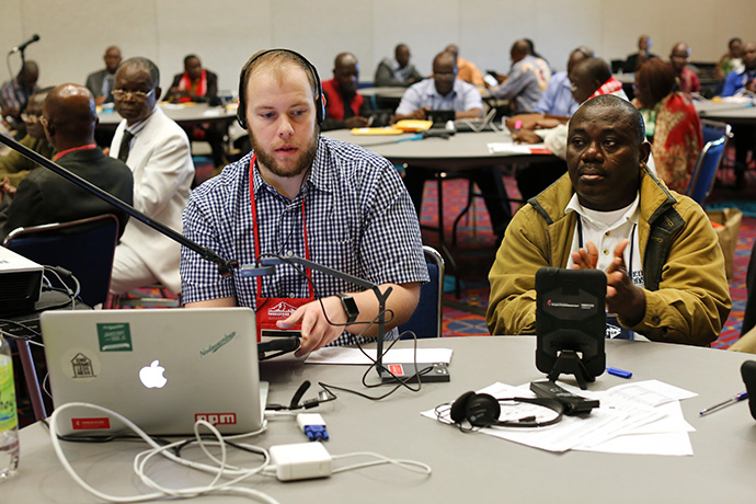 Matt Crum (left), Solutions Architect, Global Communications Technology,  was part of the tablet training team from United Methodist Communications during the 2016 United Methodist General Conference in Portland, Ore. Photo by Kathleen Barry, UMNS.