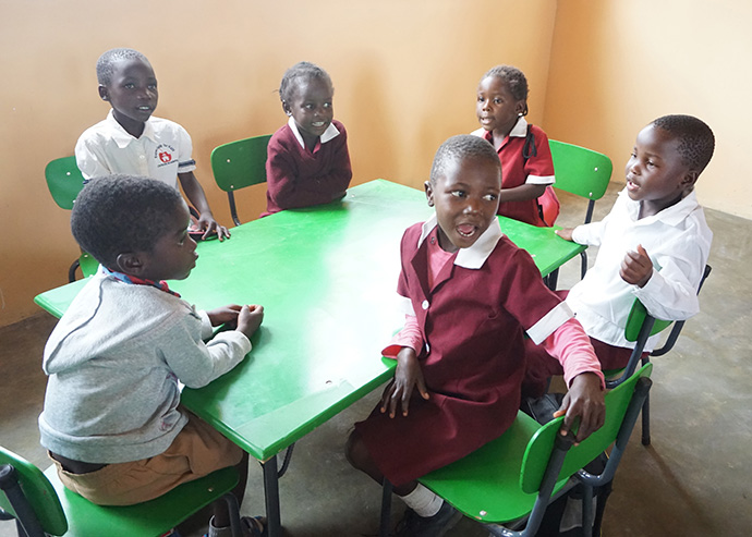 Students sit in a classroom at the new early childhood development center at Hanwa Mission School. Photo by Kudzai Chingwe, UMNS.