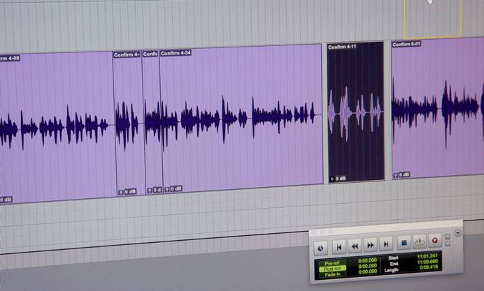 Audio waves are displayed in an editing program.
